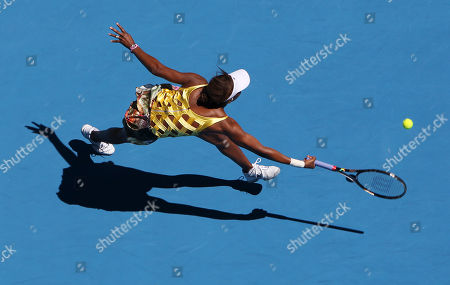 Venus Williams of the U.S. makes a forehand return to Sandra Zahlavova of the Czech Republic during their second round match at the Australian Open tennis championships in Melbourne, Australia