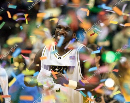 Missouri's DeMarre Carroll (1) runs through the confetti after Missouri defeated Baylor 73-60 in an NCAA college basketball game at the Big 12 Conference men's tournament in Oklahoma City