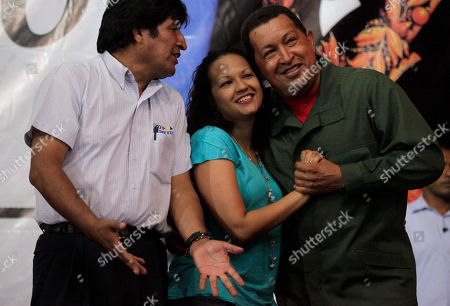 Hugo Chavez, Evo Morales, Rosa Virginia Chavez. Venezuela's President Hugo Chavez, right, embraces his daughter Rosa Virginia Chavez as Bolivia's President Evo Morales looks on as they listen to singer Eladio tarife, not seen, at an agreement signing ceremony in Barinas, Venezuela