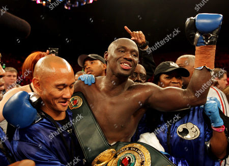 American Antonio Tarver, center, celebrates after defeating Australian champion Danny Green in their IBO cruiserweight boxing title bout at Entertainment Center in Sydney, Australia, . Tarver won the bout to clinch the title after Green's corner would not allow the fighter to start the 10th round