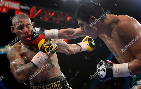 Pablo Cesar Cano, Ashley Theophane. Pablo Cesar Cano, right, lands a punch against Ashley Theophane in the eighth round during a welterweight fight, in Las Vegas