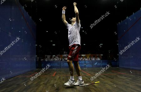England's Nick Matthew reacts after beating his compatriot James Willstrop in their men's single squash to win the gold medal during the Commonwealth Games at the Siri Fort Sports Complex in New Delhi, India