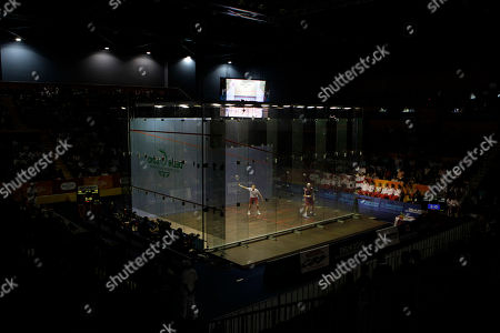 England's Nick Matthew, in white, plays against his compatriot James Willstrop, in red, in their men's single squash to win the gold medal during the Commonwealth Games at the Siri Fort Sports Complex in New Delhi, India