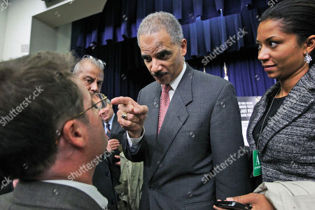 Attorney General Eric Holder points at Daily Caller reporter Neil Munro after Munro asked Holder about calls for his resignation over an investigation of arms traffickers called Operation Fast and Furious after an event on counterfeit goods at the Eisenhower Executive Office Building across from the White House in Washington
