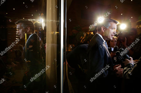 Nevada Gov. Brian Sandoval speaks with members of the media at a Republican victory party, in Las Vegas. Sandoval defeated Bob Goodman to stay governor of Nevada