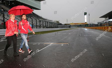 Manor driver Will Stevens of Britain walks on the track after an autograph signing event for fans ahead of the Japanese Formula One Grand Prix at the Suzuka Circuit in Suzuka, central Japan