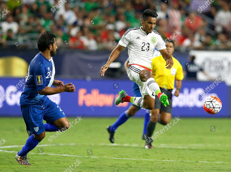 Jose Juan Vasquez, Carlos Ruiz. Mexico forward Jose Juan Vasquez clears the ball in front of Guatemala mid-fielder Carlos Ruiz during the second half of a CONCACAF Gold Cup soccer match, in Glendale, Ariz