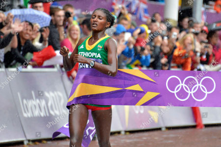 Ethiopia's Tiki Gelana crosses the finish lline to win gold in the women's marathon at the 2012 Summer Olympics, in London