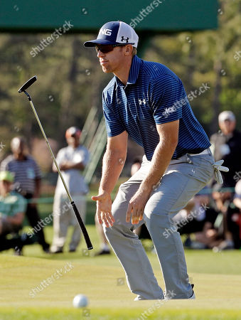 Hunter Mahan flips his putter after a birdie putt on the 17th hole during the first round of the Masters golf tournament, in Augusta, Ga