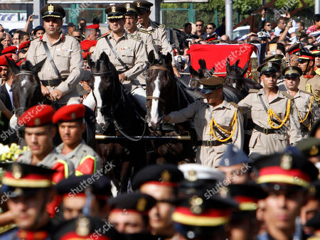 A horse drawn caisson carries the remains of Egypt's former spy chief Omar Suleiman during his funeral in Cairo, Egypt, . The 76-year-old Suleiman died Thursday in a U.S. hospital. The shadowy statesman was considered Mubarak's most trusted man, handing the regime's most sensitive issues like relations with the U.S. and Israel and the fierce battle against Islamists