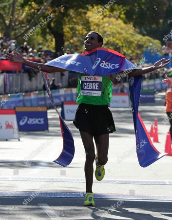 Gebre Gebremariam of Ethiopia celebrates after wnning the professional men's division at the New York City marathon in New York, . Gebremariam has won the men's title at the New York City Marathon in his debut at the distance