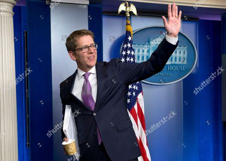 Outgoing White House press secretary Jay Carney waves following the conclusion of his final news briefing at the White House in . This was Carney's last briefing to members of the media, he is stepping down as White House press secretary and Deputy Press Secretary Josh Earnest will step into the role
