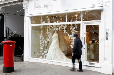 A pedestrian passes the shop of designer Phillipa Lepley in London, . Lepley is currently the bookmakers current favorites to make the wedding dress for royal bride Kate Middleton, when she marries Britain's Prince William in April 2011. Sometimes a dress is just a dress. But not in Kate Middleton's case - her wedding dress is far more than just a simple gown: It is the garment that will mark her transformation from commoner to princess, from Kate to Catherine, and define how she is seen by billions of people as they watch her exchange vows with Prince William
