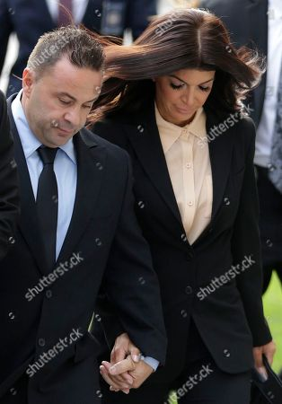 "Giuseppe ""Joe"" Giudice, Teresa Giudice. The Real Housewives of New Jersey"" stars Giuseppe ""Joe"" Giudice, left, and his wife, Teresa Giudice, of Montville Township, N.J., walk toward Martin Luther King Jr. Courthouse before a court appearance, in Newark, N.J. The Giudices are scheduled to be sentenced on federal conspiracy and bankruptcy fraud charges"