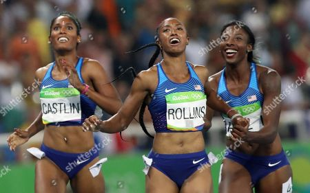 Gold medal winner Brianna Rollins, center, silver medal winner, Nia Ali, right, and bronze medal winner Kristi Castlin, all from the United States, pose with their country's flag after the 100-meter hurdles final,during the athletics competitions of the 2016 Summer Olympics at the Olympic stadium in Rio de Janeiro, Brazil