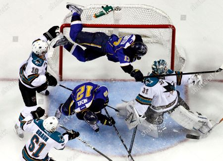 Justin Braun, Dominic Moore, Antti Niemi, Scott Nichol, Vladimir Sobotka. St. Louis Blues' Vladimir Sobotka, top, of the Czech Republic, goes flying into the goal over San Jose Sharks goalie Antti Niemi, right, of Finland, and Blues' Scott Nichol (12) as Sharks' Dominic Moore (18) and Justin Braun (61) watch during the second period in Game 2 of an NHL Stanley Cup first-round hockey playoff series, in St. Louis
