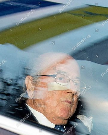 """FIFA President Sepp Blatter, left, and his lawyer Lorenz Erni, right, arrive in a car at the FIFA headquarters """"Home of FIFA"""" in Zurich, Switzerland, Thursday morning, . While FIFA President Joseph S. Blatter will appear in person on Thursday before the panel of four judges of the FIFA ethics court, UEFA President Michel Platini plans to boycott his hearing on Friday 18 December. Blatter and Platini were banned for 90 days for all activities in football"""