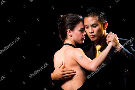 Stock Photo of Caelyn Casanova, Johnny Nguyen. U.S. couple Caelyn Casanova, left, and Johnny Nguyen, from Los Angeles, Calif., dance during the 2013 Tango World Championship salon category in Buenos Aires, Argentina