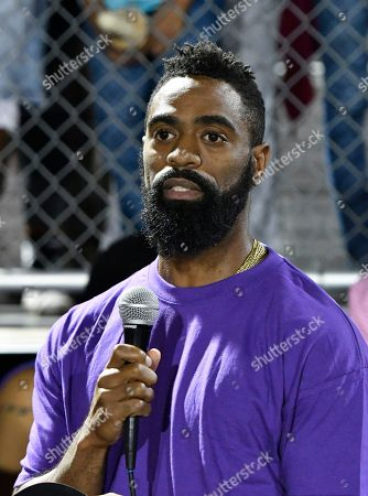 Former Olympian Tyson Gay speaks to the mourners gathered in memory of his daughter Trinity at Lafayette High School, in Lexington, Ky. Several thousand people, including Tyson Gay, turned out Monday night for a candlelight vigil in Kentucky to honor Gay's 15-year-old daughter, who was fatally shot over the weekend