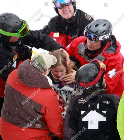 Hannah Teter is tended to after a crash in the women's halfpipe finals at the U.S. Open Snowboarding Championships in Stratton, Vt., on