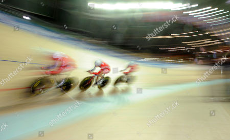 Wendy Houvenaghel, Elizabeth Armistead, Joanna Roswell. The British Women's Team Pursuit team with Wendy Houvenaghel, Elizabeth Armitstead and Joanna Rowsell speed on the track during their qualifying heat in the World Track Cycling Championships at Pruszkow, near Warsaw, Poland