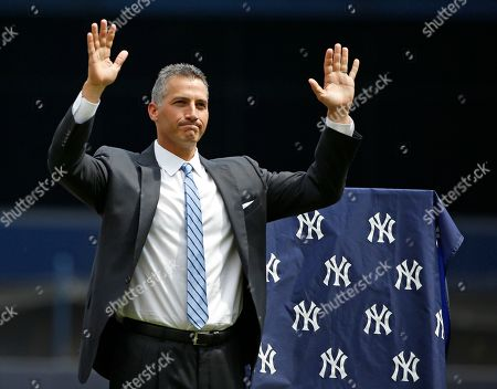 Retired New York Yankees pitcher Andy Pettitte acknowledges the crowd during a pregame ceremony retiring his number before a baseball game in New York