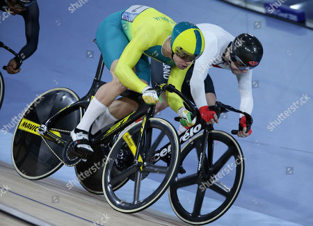 Australia's Matt Glaetzer, left, and England's Philip Hindes during the Men's Keirin first round heats at the Anna Meares Velodrome during the 2018 Commonwealth Games in Brisbane, Australia