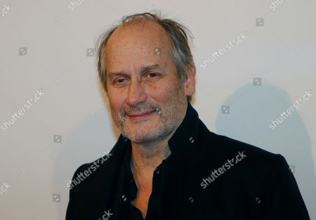 """French actor and director Hippolyte Girardot poses before the French premiere of """"Isle of Dogs"""" in Paris, France"""