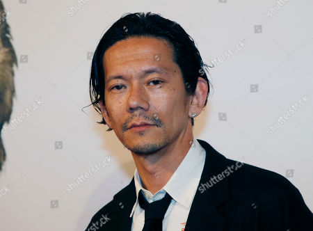 "Japanese actor Kunichi Nomura poses before the French premiere of ""Isle of Dogs"" in Paris, France"