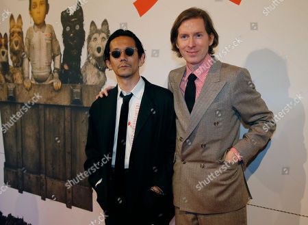"Japanese actor Kunichi Nomura, left, and American director Wes Anderson pose before the French premiere of ""Isle of Dogs"" in Paris, France"