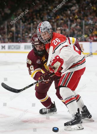 Mason Jobst, Justin Richards. Ohio State's Mason Jobst (26) and Minnesota Duluth's Justin Richards (19) look to the puck in the first period of the NCAA Frozen Four semifinal game, in St. Paul, Minn