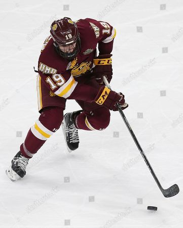 Minnesota Duluth's Justin Richards (19) controls the puck against Ohio State during the second period of a semifinal in the NCAA men's Frozen Four hockey tournament, in St. Paul, Minn. Minnesota Duluth won 2-1
