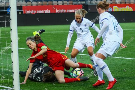 Finland's goalkeeper Tinja-Riikka Korpela (2-L), defender Emma Koivisto (2-R) and defender Anna Westerlund (R) in action against Spain's defender Irene Paredes (L) during the FIFA Women's World Cup Qualifying round - Group 7 match between Finland and Spain played at Helsinki Football Stadium, in Helsinki, Finland, 06 April 2018.