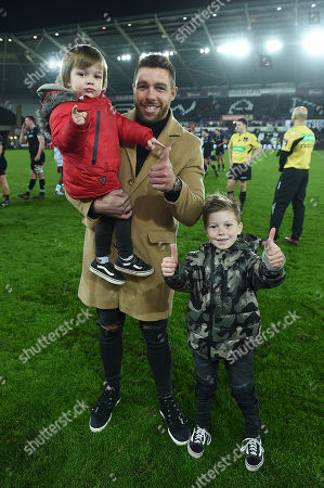 Rhys Webb of Ospreys with his sons Jesse and Regan at the end of the game.