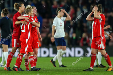 Melissa Fletcher, Rachel Rowe and Jessica Fishlock of Wales celebrate after the final whistle