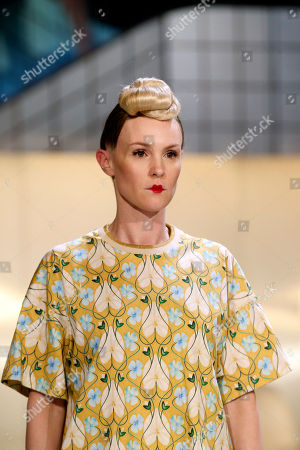 A model wears a creation designed by Belgian singer Stromae and his wife Coralie Barbier for Mosaert, in Paris