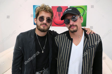 Venezuelan artists and siblings Ricky (L) and Mau (R), sons of singer Ricardo Montaner, pose during an interview at the Sony Music facilities in San Juan, Puerto Rico, 06 April 2018. Mau and Ricky presented their new song 'Mi mala'.