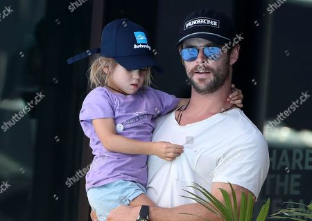 Australian actor Chris Hemsworth holds his daughter India Rose as they watch swimming heats at the Aquatic Centre during the 2018 Commonwealth Games on the Gold Coast, Australia