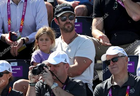 Chris Hemsworth, India Rose Hemsworth. Australian actor Chris Hemsworth holds his daughter India Rose as they watch swimming heats at the Aquatic Centre during the 2018 Commonwealth Games on the Gold Coast, Australia