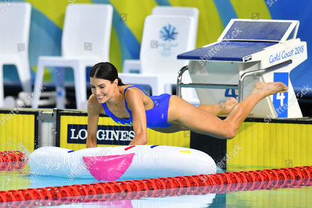 Australian singer Erin Holland jumps into the water during a celebrity swimming race on day three of swimming competition at the XXI Commonwealth Games at Gold Coast Aquatic Centre on the Gold Coast, Australia, 07 April 2018.