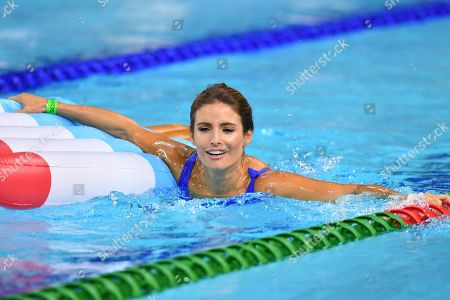 Stock Photo of Ada Nicodemou floats in the water during a celebrity swimming race  on day three of swimming competition at the XXI Commonwealth Games at Gold Coast Aquatic Centre on the Gold Coast, Australia, 07 April 2018.