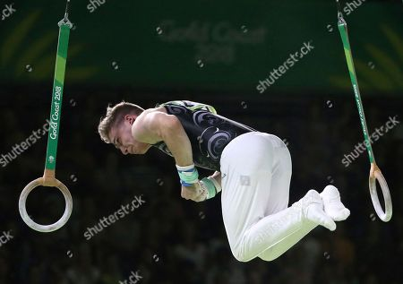 New Zealand's Ethan Dick competes on the rings during the men's individual artistic gymnastics competition at Coomera Indoor Stadium during the Commonwealth Games on the Gold Coast, Australia