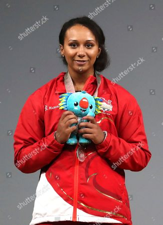 England's Silver medalist Zoe Smith holds Commonwealth Games mascot Borbi during the medal ceremony at the Commonwealth Games in Gold Coast, Australia