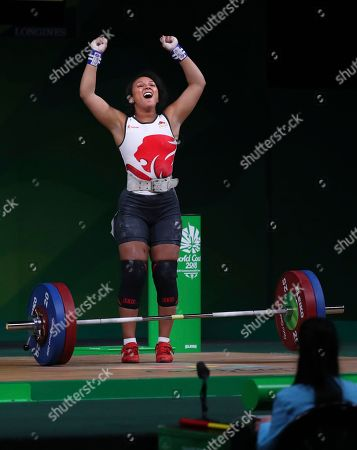 England's Zoe Smith celebrates after her final lift in snatch in Women's 63kg Weightlifting final during Commonwealth Games in Gold Coast, Australia, . Smith won Silver medal in her category