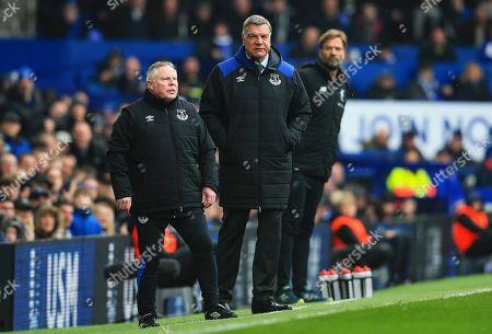 Everton manager Sam Allardyce watches with coach Sammy Lee