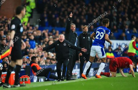 Everton manager Sam Allardyce and coach Sammy Lee appeal to the linesman