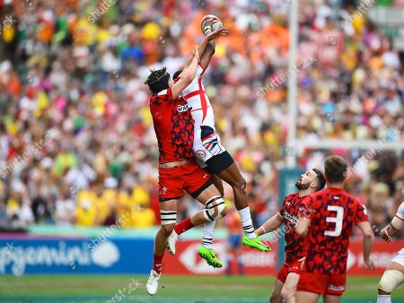 USA player Perry Baker wins the high ball during a restart in the game USA vs Wales during the Cathay Pacific/HSBC Hong Kong Sevens festival at the Hong Kong Stadium, So Kon Po, Hong Kong. on 7/04/2018. Picture by Ian  Muir