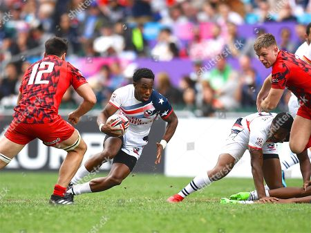 USA player Carlin Isles finds a gap in the Welsh defence during the game USA vs Wales during the Cathay Pacific/HSBC Hong Kong Sevens festival at the Hong Kong Stadium, So Kon Po, Hong Kong. on 7/04/2018. Picture by Ian  Muir