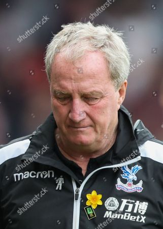 Crystal Palace Assistant Manager Ray Lewington who played alongside recently deceased Ray Wilkins in  the 1980's  Chelsea Midfield  with a look of dejection.