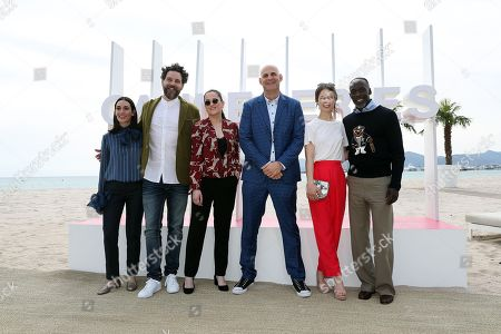 (L-R) Jury members of Cannes Series, Turkish actress Melisa Sozen, Canadian producer Juan Cristobal Tapia de Veer, French director Audrey Fouche, US writer Harlan Coben, Paula Beer and US actor Michael Kenneth Williams pose during the photocall at the 1st Cannes Series Festival in Cannes, 07 April 2018. The event will take place from 04 to 11 April.